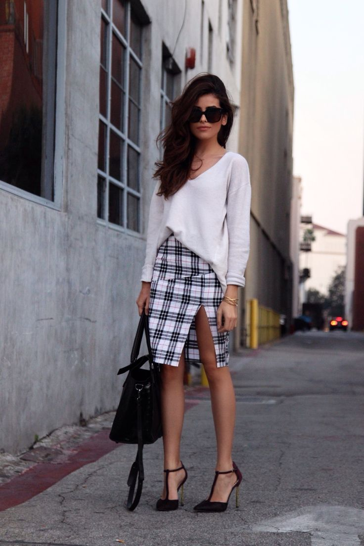 e4c4a6bd10a71f A high slit adds boldness to a plaid skirt. | City Chic | Fashion ...