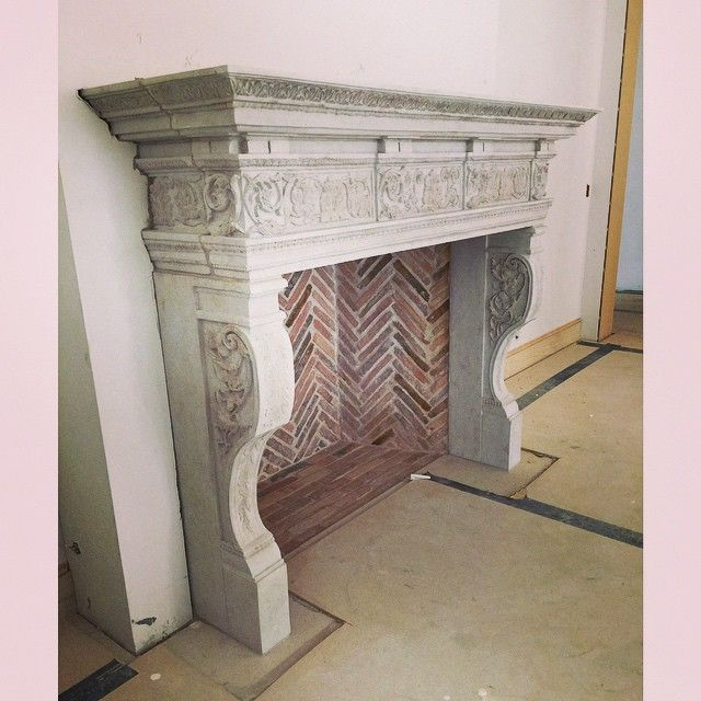Another antique reproduction by RF Imports installed with antique French firebricks. #fireplace #fire #mantle #mantel #handmade #french #limestone #firebrick #brick #antique #firebox #import #dallas #texas #rfimports