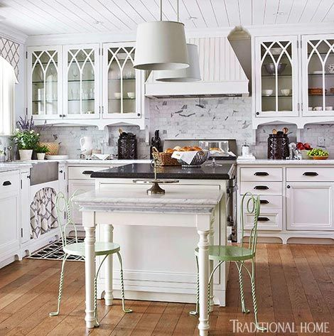 White Kitchen Cabinets With Gothic Style Arched Muntins