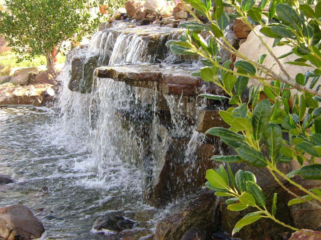 Pondless water features landscape waterfalls pondless for Garden pool fountains