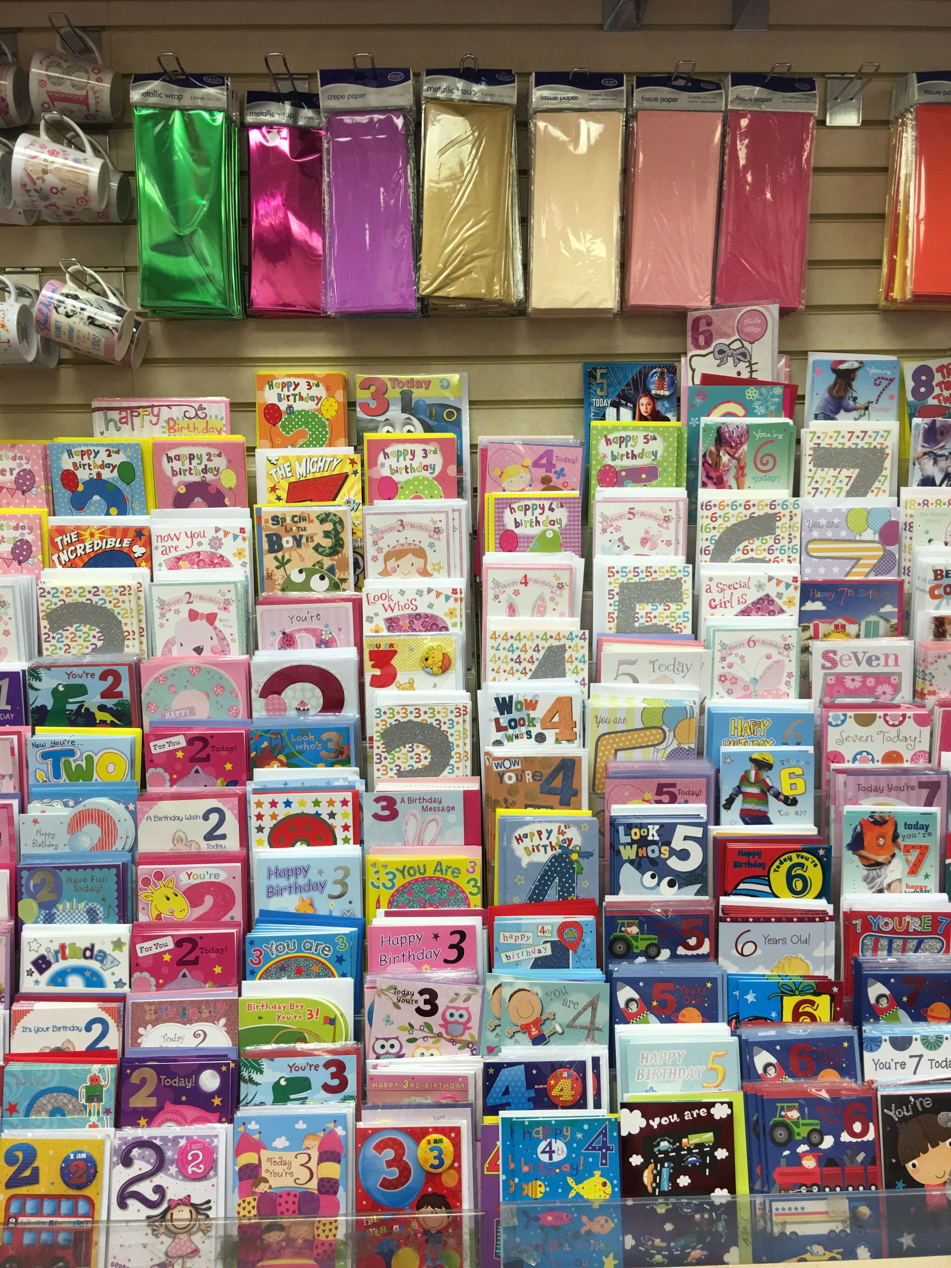 Greeting Card Display With Slatwall Board And Slatwall Hooks Above