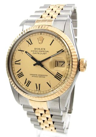 E.D. Marshall Jewelers Men's Rolex DateJust with automatic movement. Features include; Hours, Minutes, Seconds and date at 3 o' clock position. Case material is 18K gold and stainless steel. This Men's Rolex DateJust has a 36mm diameter, 18kt gold fluted bezel, 18kt yellow gold dial & black roman numeral markers. The bracelet is 18K yellow gold  steel with a deployment clasp. This watch is 100 meters water resistant, has acrylic crystal and is Swiss made. Rolex Reference Number: 16013