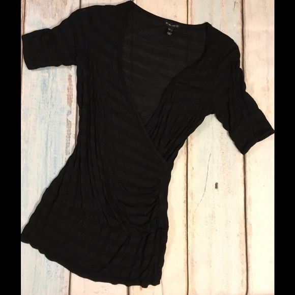 Deep V Top Excellent condition. No stains or holes. Black strips. Large Fang Tops