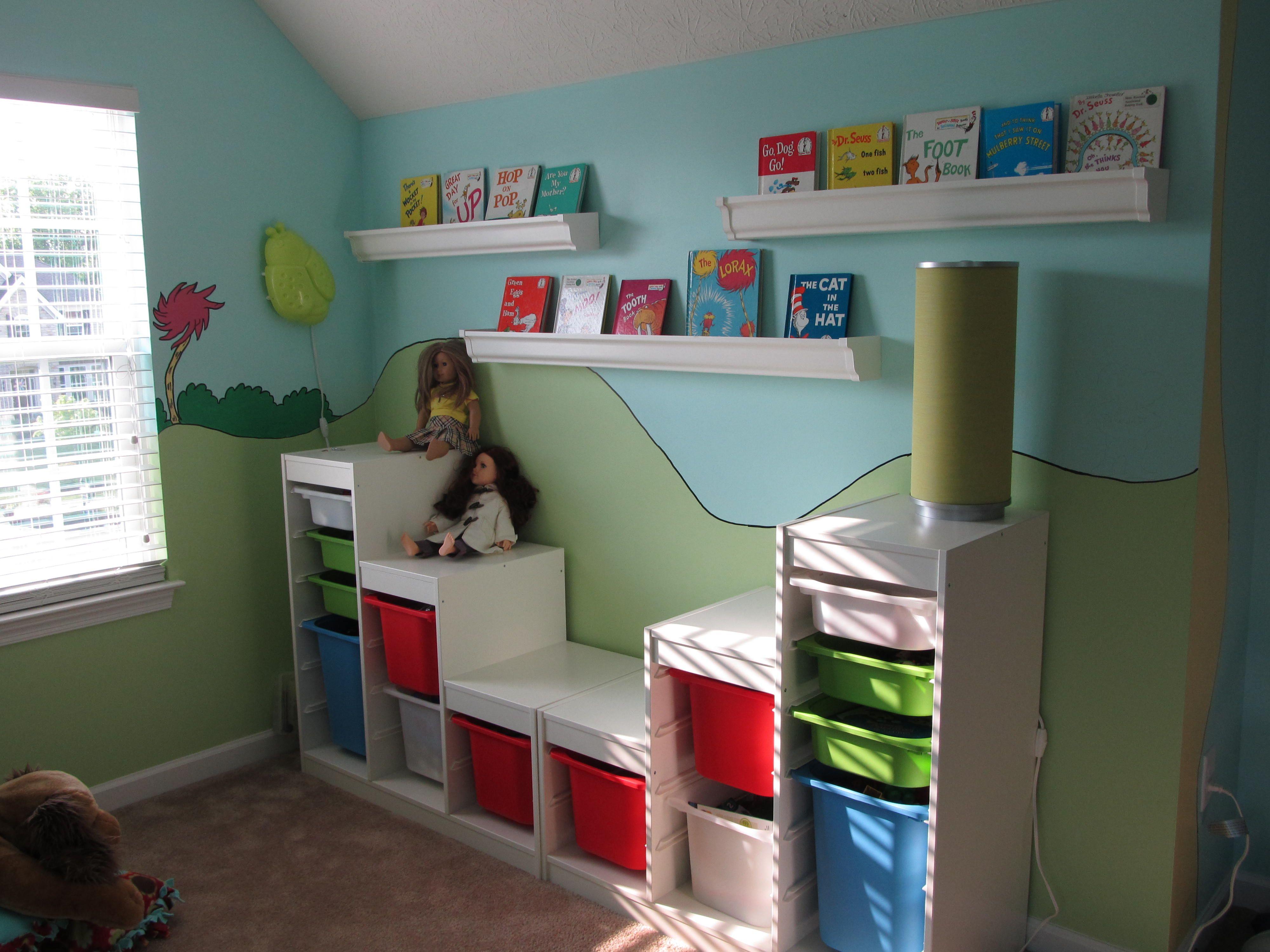 Dr. Seuss theme playroom. Trofast shelves from Ikea, rain gutter  bookshelves.