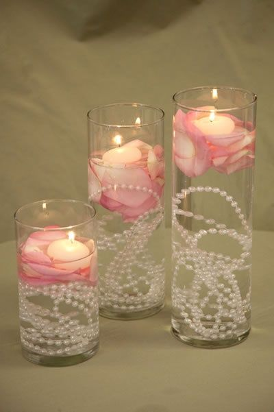 Necklaces in the cylinders! A pretty cool idea for a centerpiece