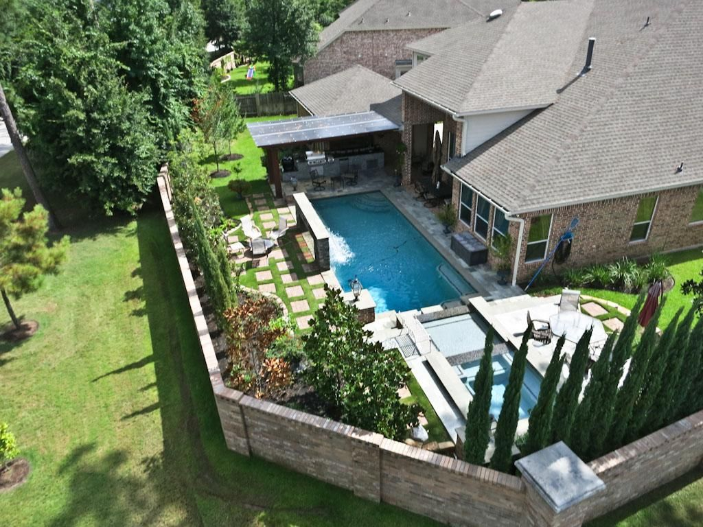 Rear Backyard Aerial View Of Masonry Fence Around Pool And