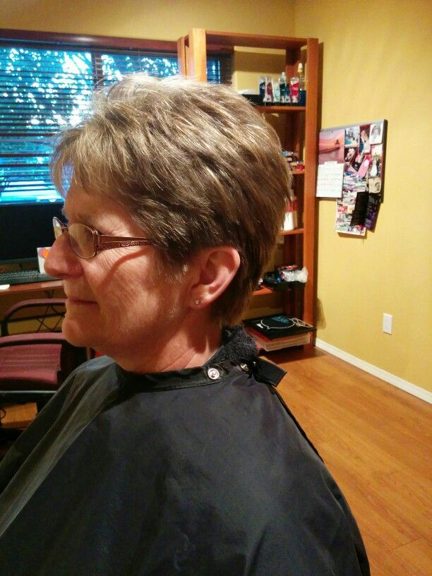 Cut with razor in back, scissors on the side, razor in front of ears, scissor top and razor for texture and removing weight