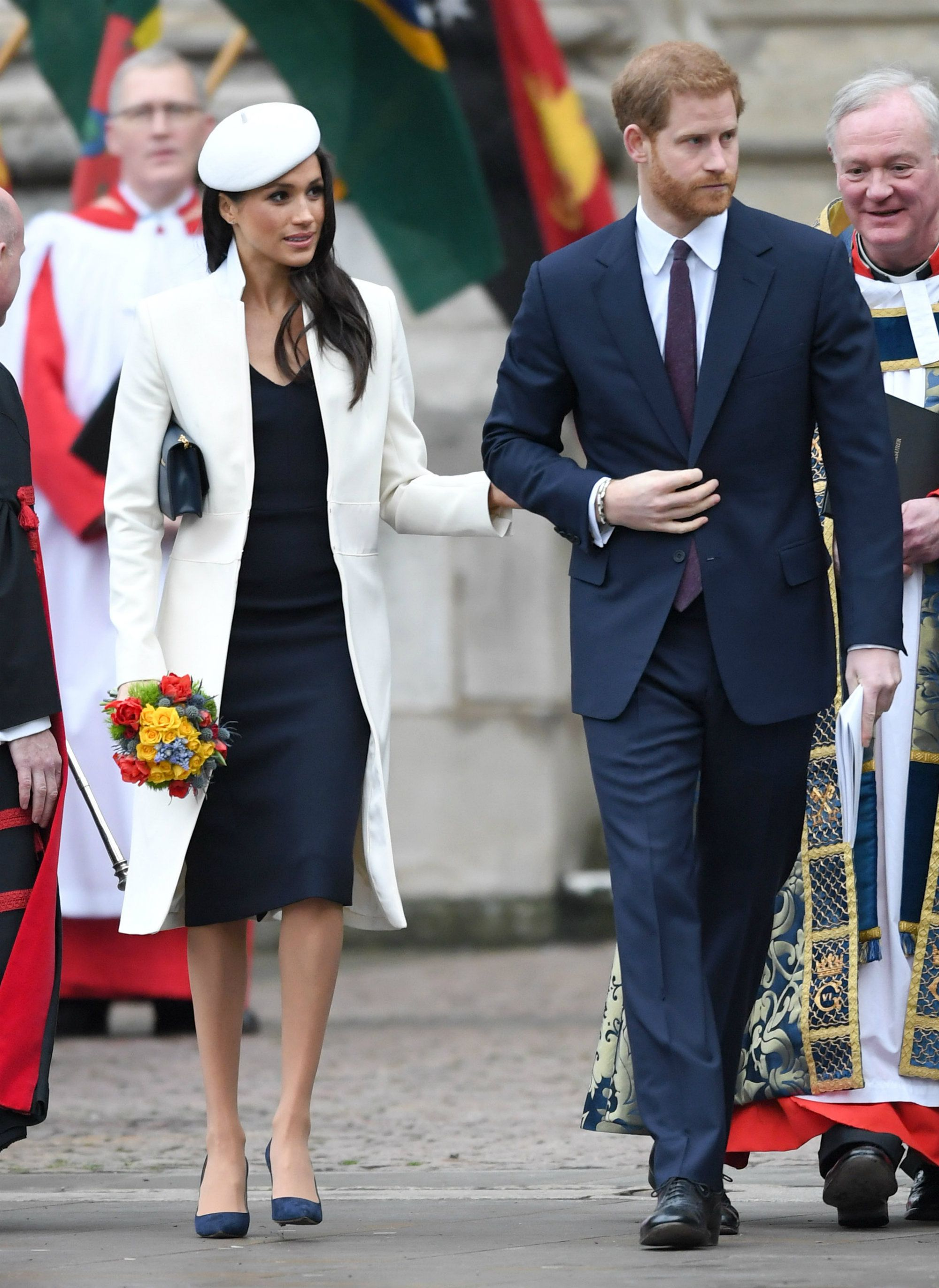 Prince Harry and Meghan Markle Got Caught Laughing in Church Yesterday pics