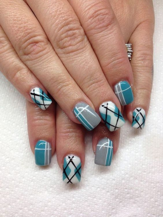 A cute and quirky looking plaid nails art design. The fresh color  combination of white, green blue, gray and black colors are visually  appealing and simply ... - 35 Gingham And Plaid Nail Art Designs Plaid Nails, Nail Pics And
