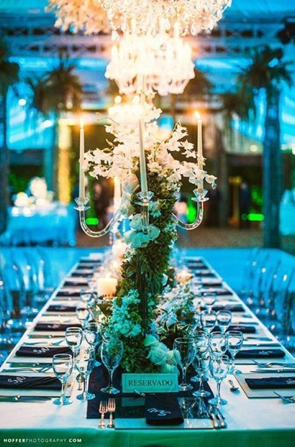 Cover a crystal candelabra with greenery for an enchanting centerpiece | Hoffer Photography