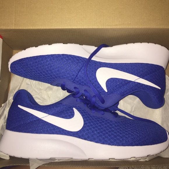 d72814db01ad2 Nike Tanjun royal blue and white Very light weight great workout shoe. Rich  color a 7 in men so that s an 8 1 2 in women s. Nike Shoes Athletic Shoes