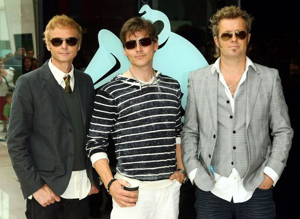 Magne Furuholmen (L-R)  Paul Waaktaar-Savoy, Morten Harket and Magne Furuholmen of the Norwegian pop band A-Ha pose for photographs during a free acoustic show at the Westfield shopping centre in west London, on July 28, 2009. A-Ha were launching their new album 'Foot of the Mountain.' on July 28, 2009 in London, England.