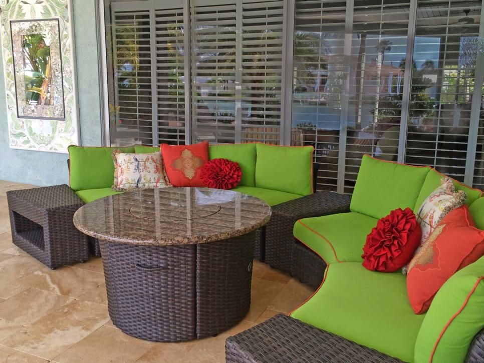This spacious brown wicker patio furniture boasts colorful ...