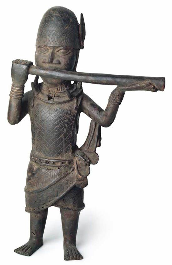 Musician with Transverse Horn: Benin Nigeria. 17th/18th century. This figure is usually seen as a court official whose job it was to herald the arrival of the Oba's royal entourage with the blow of his horn during public processions.