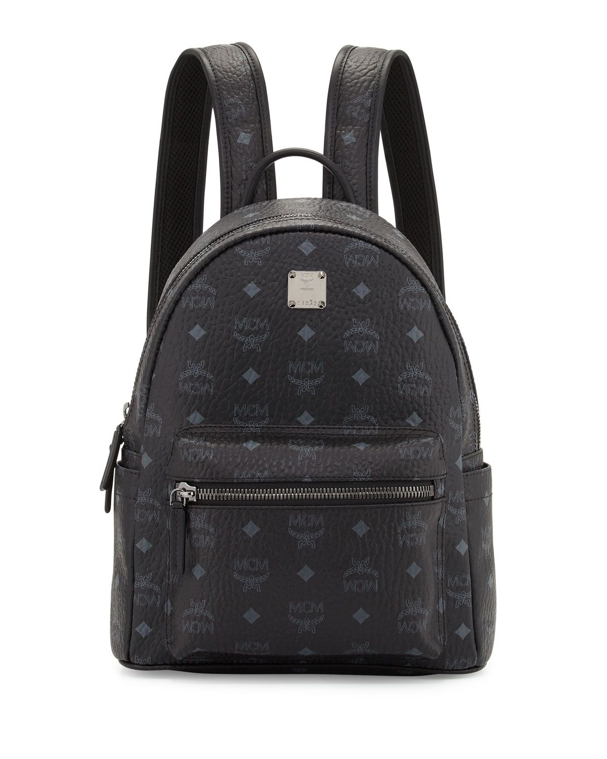 MCM monogrammed backpack in coated canvas. Rolled top handle  3.3