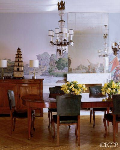 In the dining room, Crest chairs by Kristen Buckingham, a 20th-century mahogany table, a French buffet from Amy Perlin Antiques, and L'Hindoustan wallpaper by Zuber.   - ELLEDecor.com