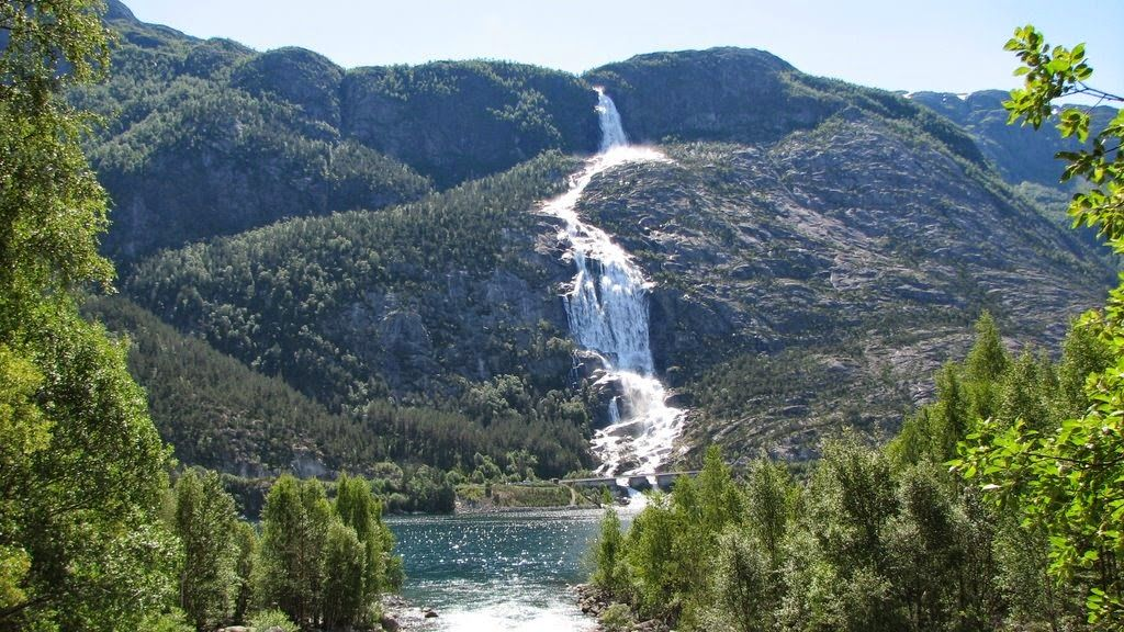 Langfossen by Langfossen is a waterfall located in the municipality of Etne in western Norway. The total fall is around 600 meters, where it leaps out into Åkrafjorden. #waterfall #nature #landscape #photo #travel