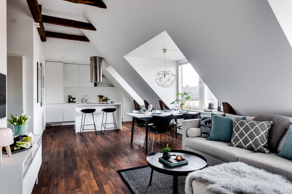 Kitchen At The End Of The Open Plan Living Space Inside The Small Attic Apartment Decoist Apa In 2020 Attic Living Rooms Apartment Living Room Design Attic Apartment