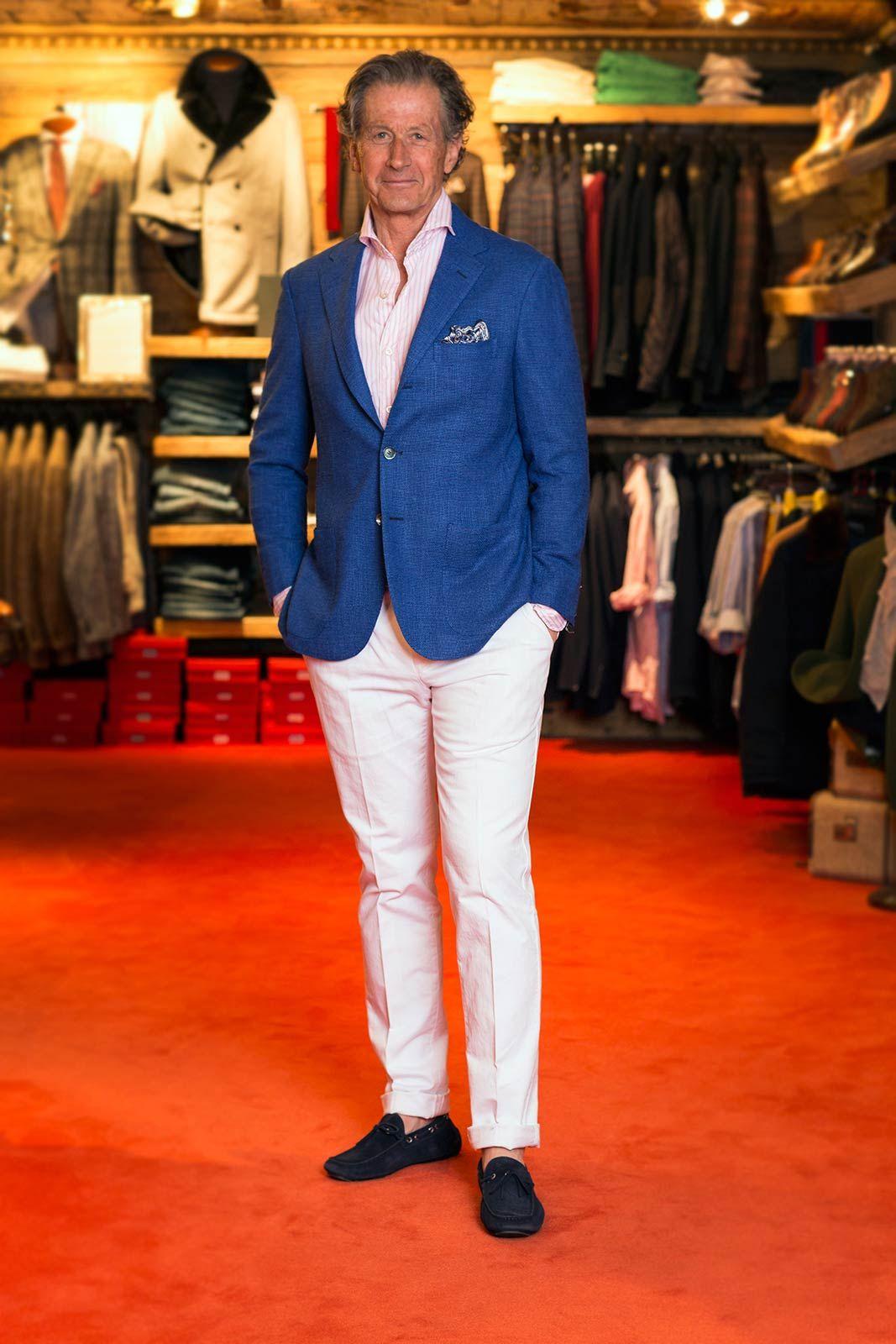 Axel wearing SartorioGinoble Royal Sport Coat, FinamoreSergio Double White/Pink Stripe Sport Shirt, Pantaloni TorinoSlim Fit Feleti Trousers In White & Kiton Atvani Drivers. Visit us at www.axelsltd.com for more information or call us at(970) 497-4888.