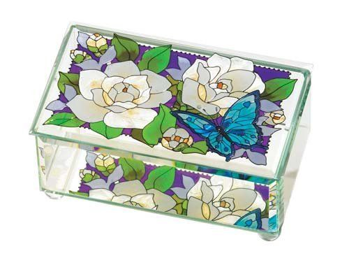 Joan Baker Designs BAB3004 Gardenias Art Glass Box, 6.75 by 4 by 3-Inch by Joan Baker Designs. $30.13. Beveled on all sides and lid. Hand-painted art glass box. Mirrored bottom. So vivid that you can almost smell the sweet scent of Gardenias. Clusters of blooms grace a background of purples and blues, passionate but cool.. This hand-painted art glass box makes a wonderful Mother's Day gift. Gardenias box features lift-off lid and glass ball feet.