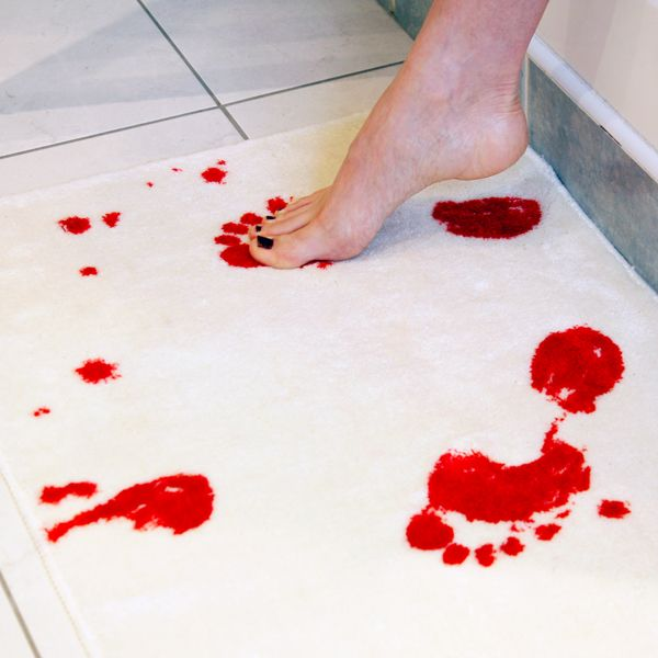 Bath mat that turns red when wet. Rather it be pink so it doesn't look like blood