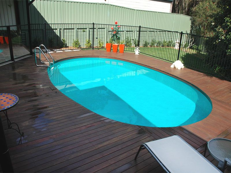 Decking, tiling or paving over pool coping