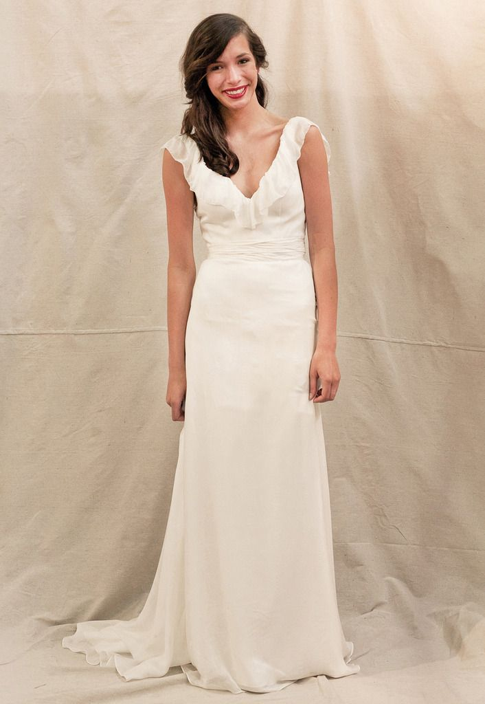 Ivy Aster Anemone Off White Silk Wedding Dress Has A V Neck Lined With Ruffles Draping Over The Shoulder Which Continues Down Low Back Creating Fe