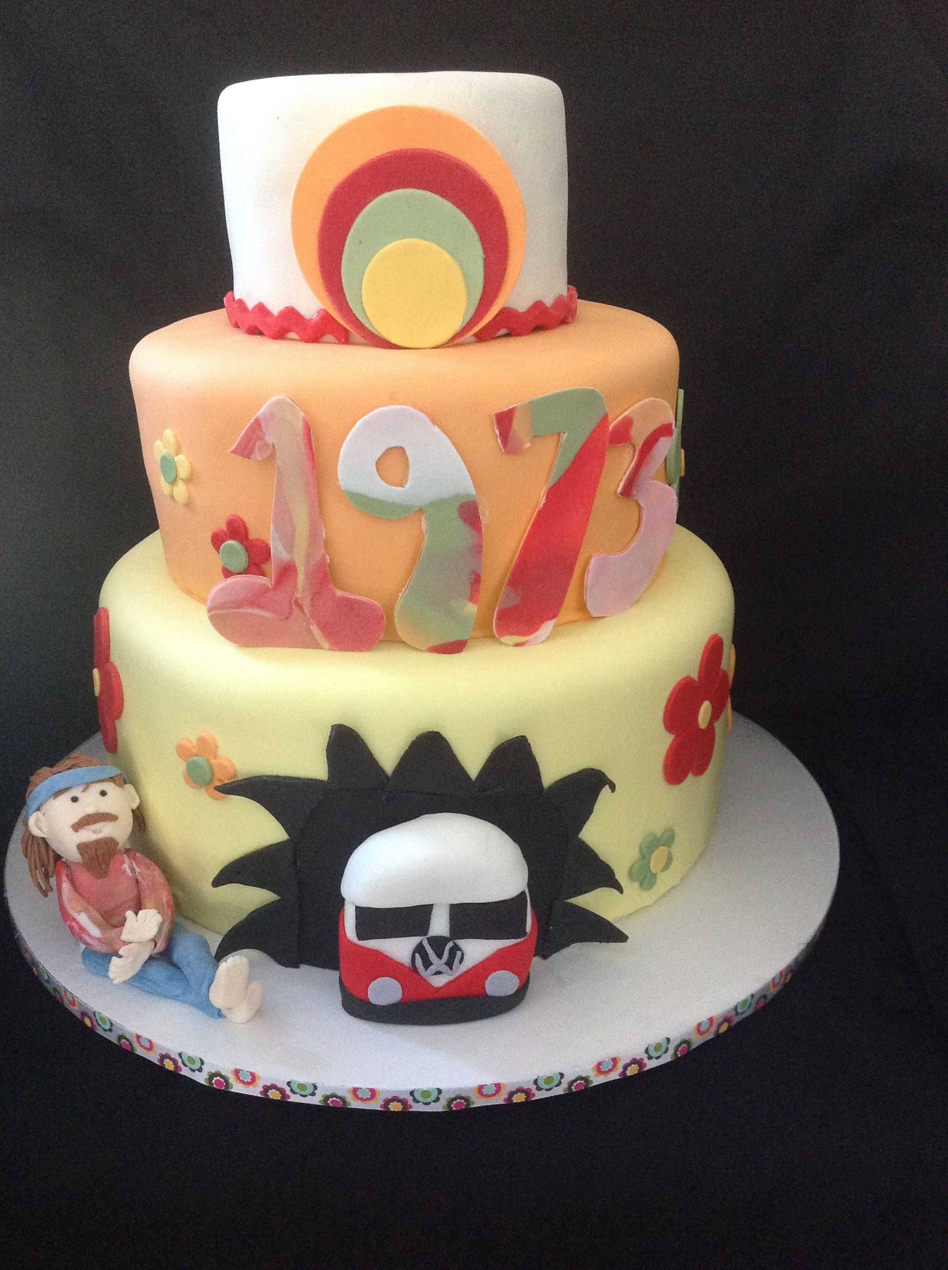 1970s cake with hippie and vw bus by amy hart cake