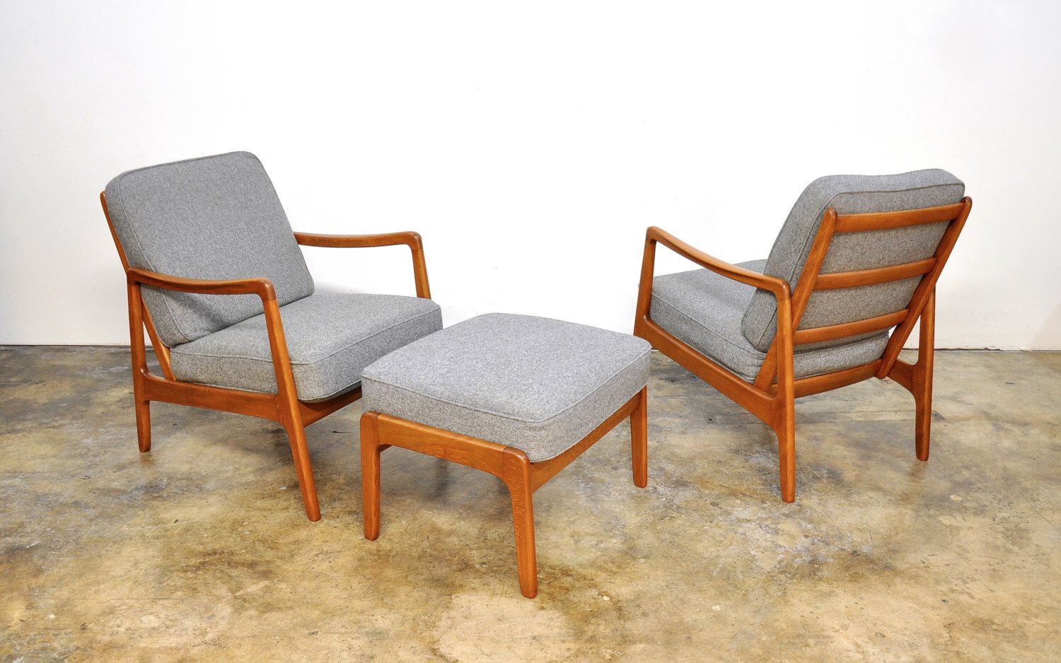 pair of ole wanscher danish modern lounge chairs and ottoman by