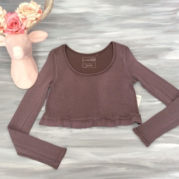 H.P.Free People Cropped Thermal We the free for free people clothing. Faded eggplant color with intentional variance in color from lighter to darker throughout. It is a hand dyed garment. NWT Cropped thermal top with scoop neck and ruffled hemline; 50% cotton 50% polyester. Super cute!! Free People Tops