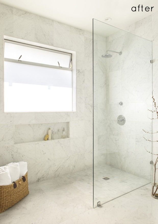 Walk-in standing shower with glass wall and no door. No ledge. Floor ...