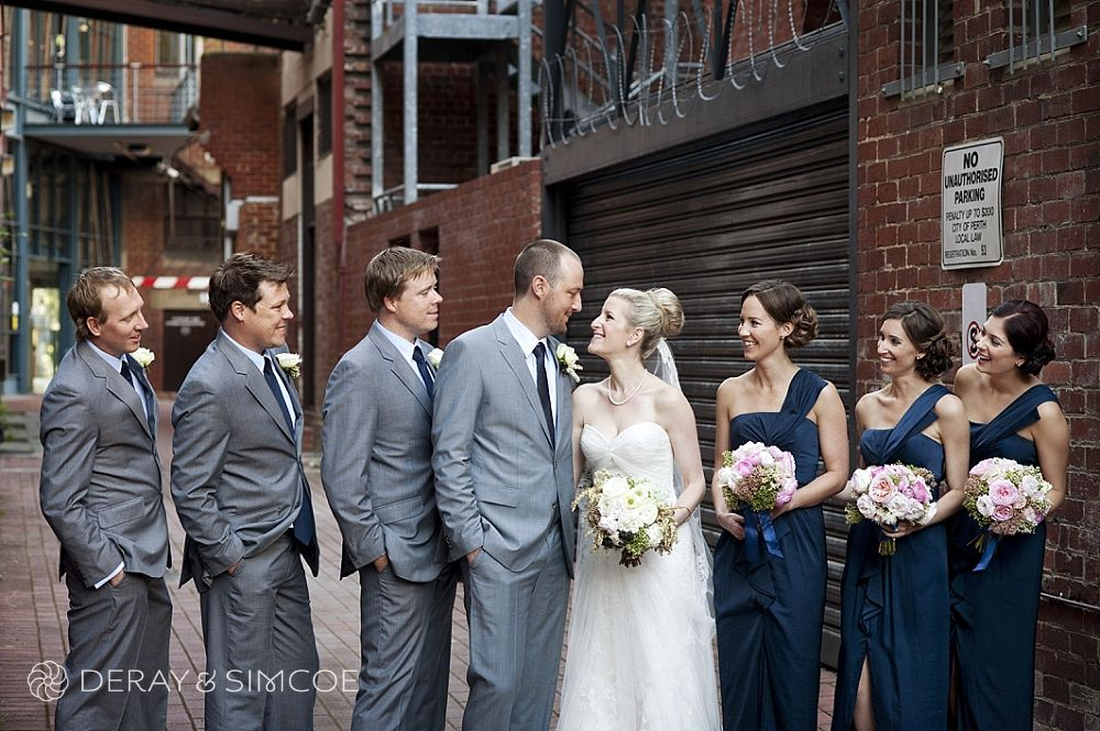 Urban Wedding Photos Modern Bridal Party Bridesmaids Dressed In Navy Blue With Pastel Bouquets