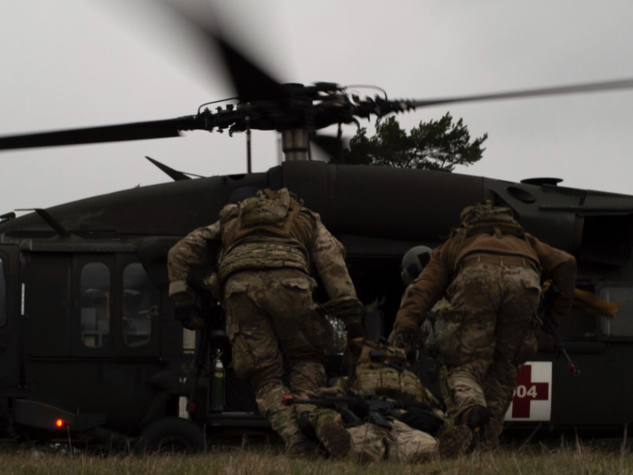 Airmen From The 2nd Air Support Operations Squadron Drag A Simulated Casualty For Medical Evacuation During Training Close Air Support Military Heroes Airman