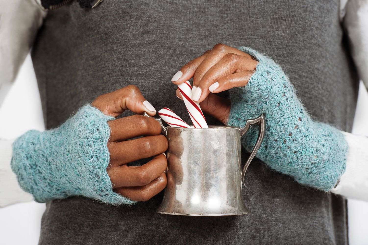 These cozy arm warmers featuring a delicate eyelet pattern in icy blue hues are sure to warm your heart and hands this season.