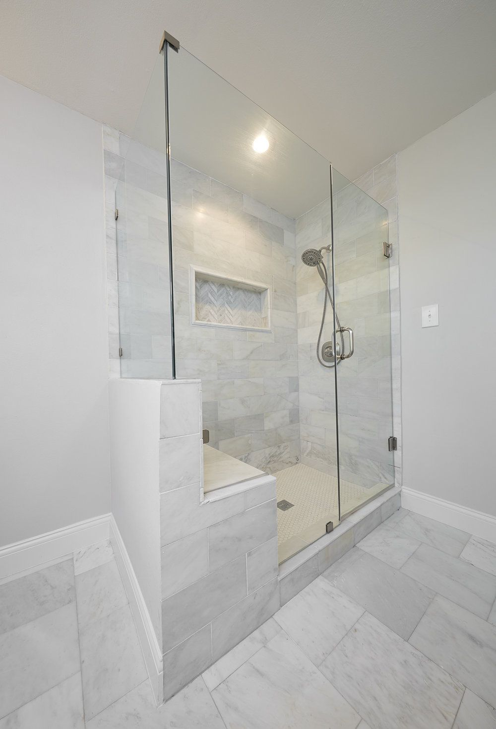 Love this extra large white marble master shower with for Large glass wall tiles