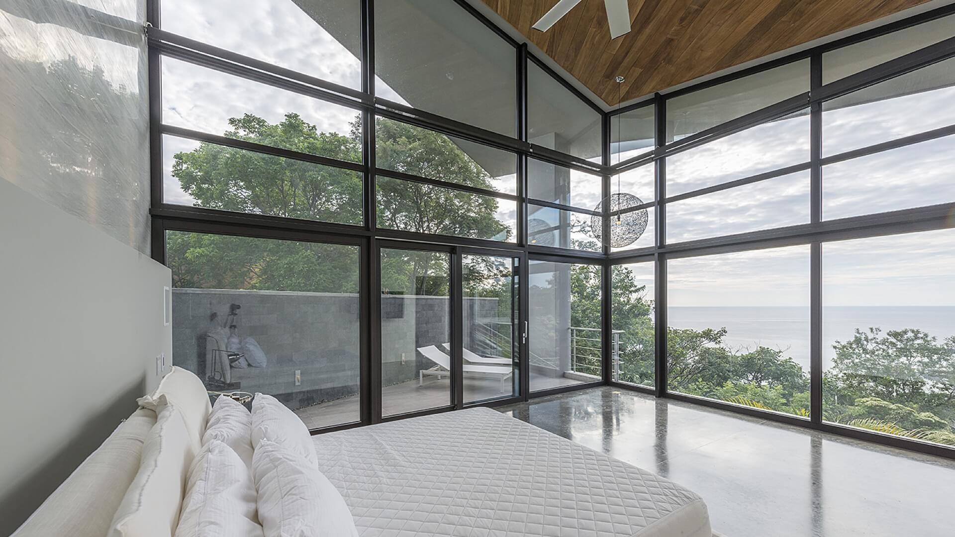 "Kind of similar to how the master bedroom should have glass on all three sides, but all the glass walls should be retractable, so in the morning, the whole bedroom can be ""opened up"" to the Caribbean breeze"
