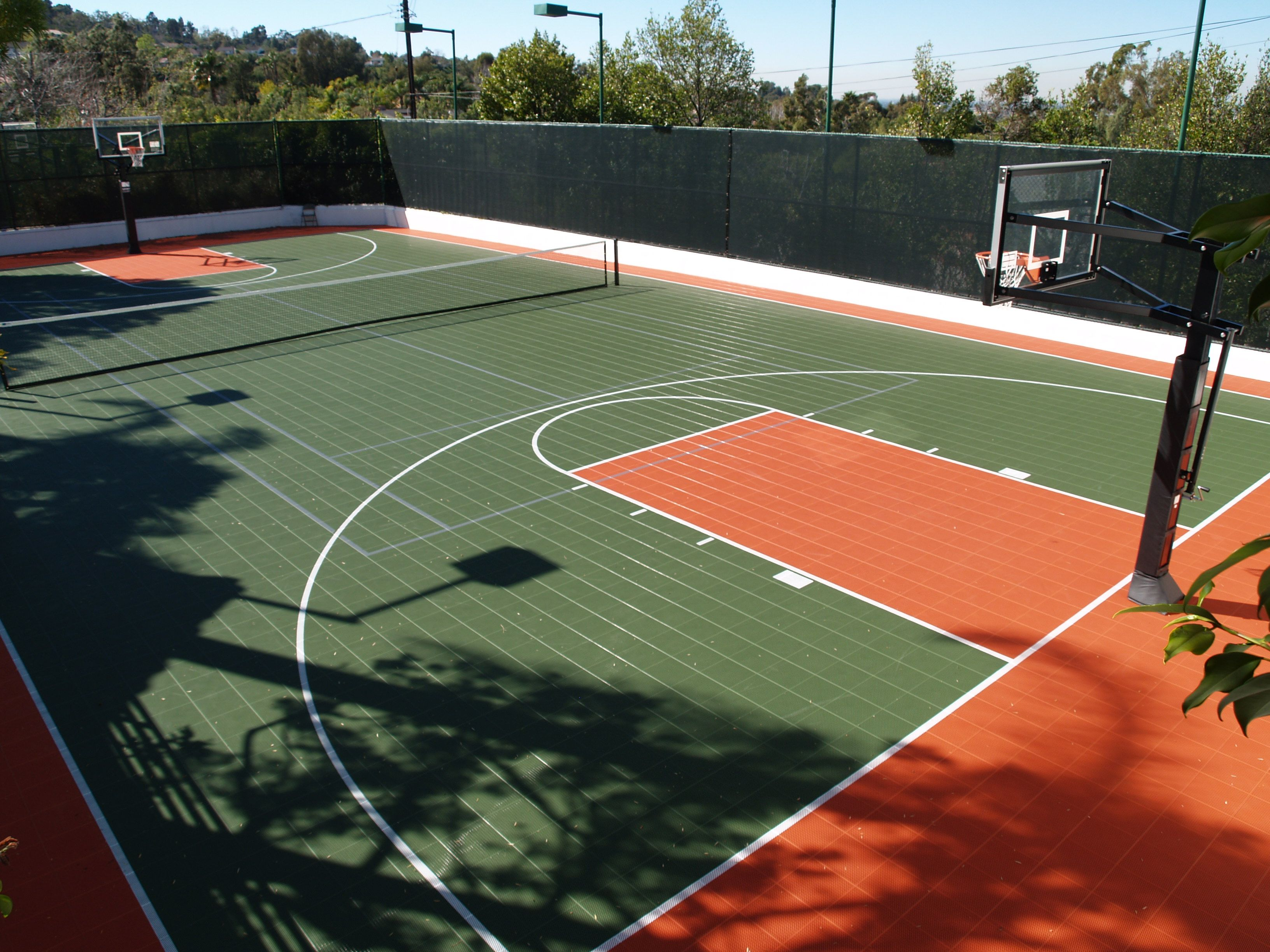 This Backyard Mulit Game Court Is Perfect For The Basketball And Tennis Lover Home Basketball Court Backyard Court Sports Court Flooring