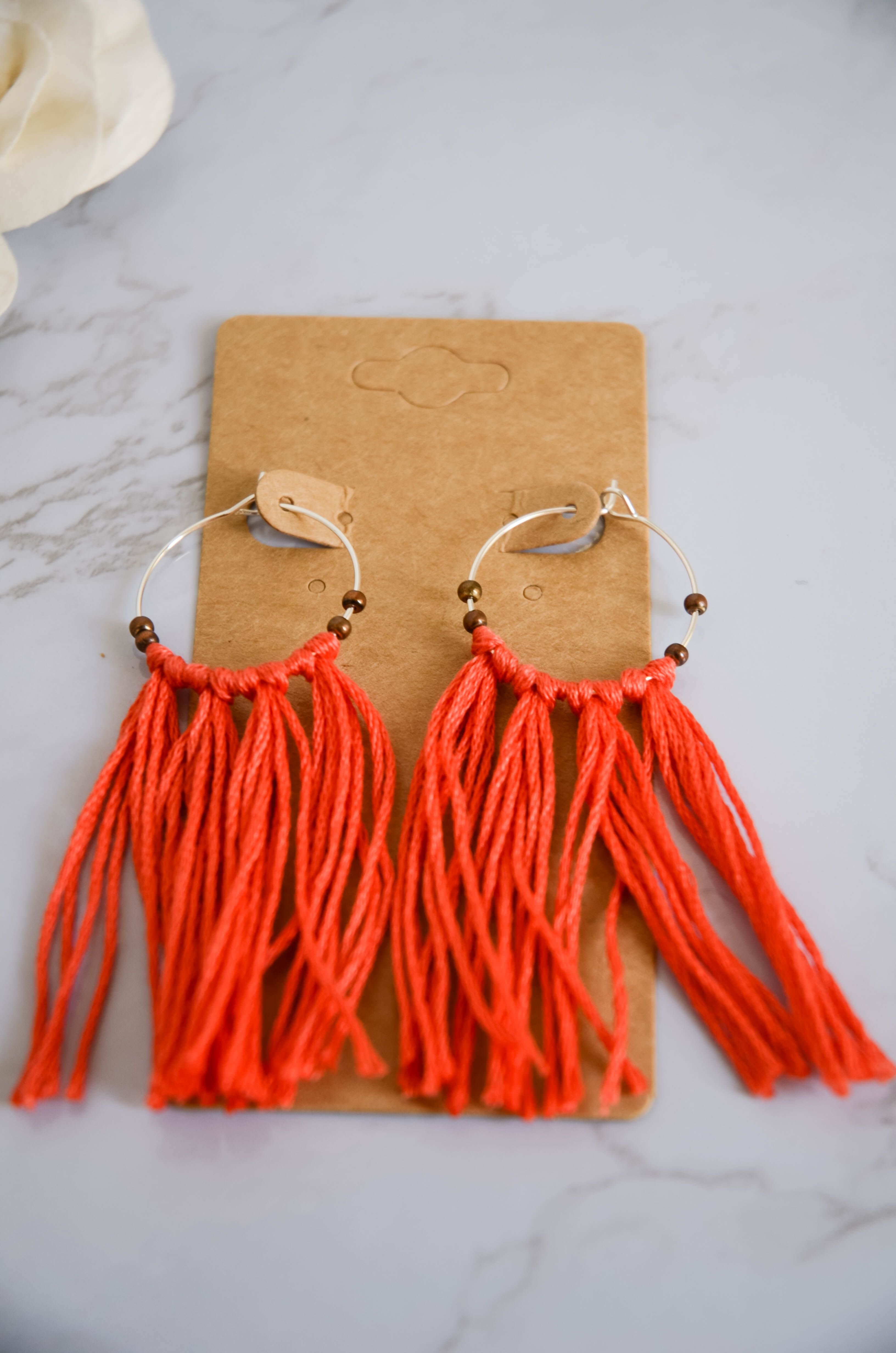 Red earrings in cotton and beads
