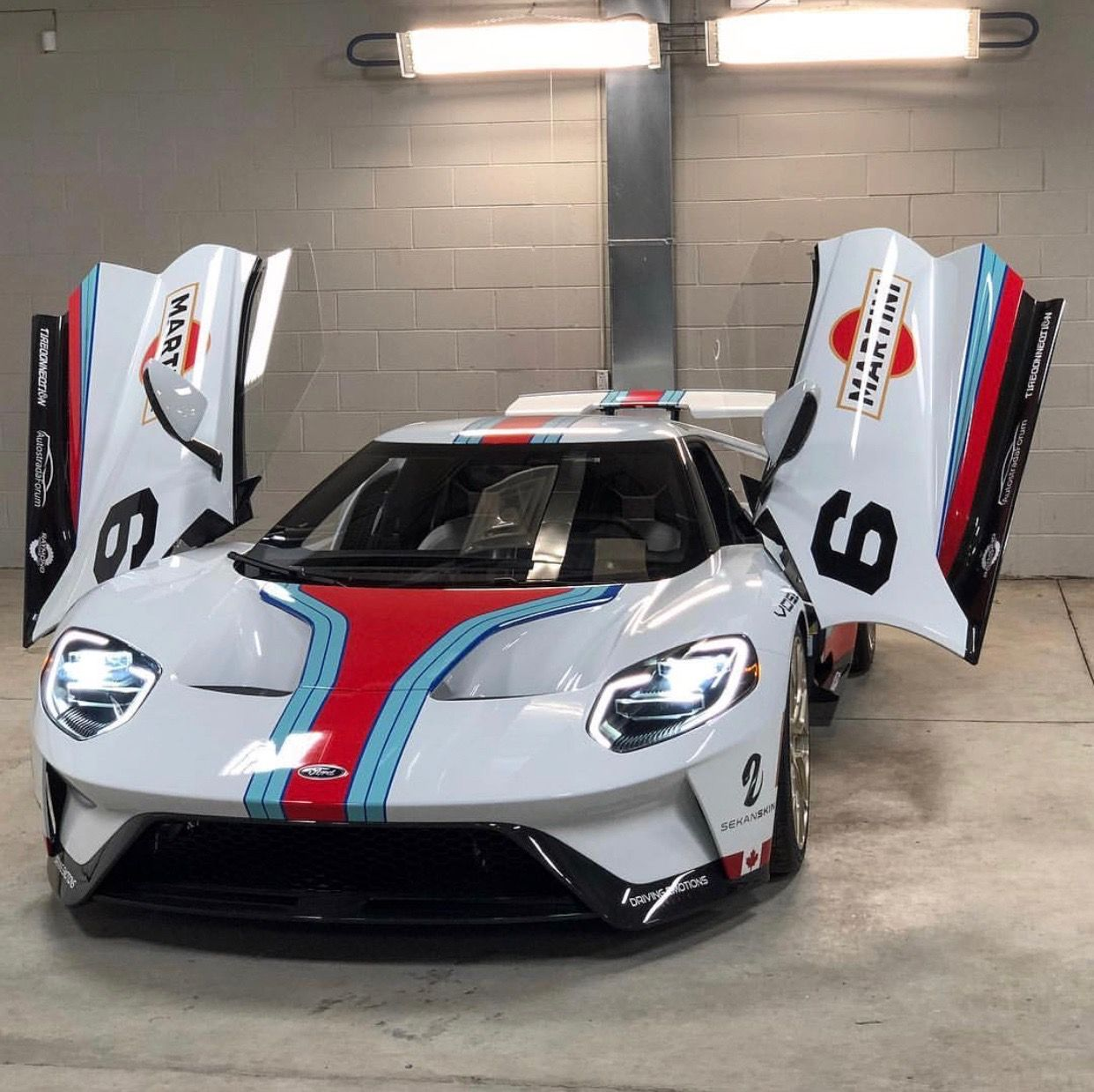 Ford Gt Painted In White W A Full Martini Livery A Black Number 6 Under Each Side View Mirror And A Set Of Vossen Forged S17 0 Ford Gt Ford New Sports Cars