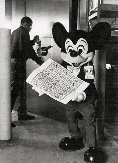 Mickey with the first Disney Dollars, 1987.