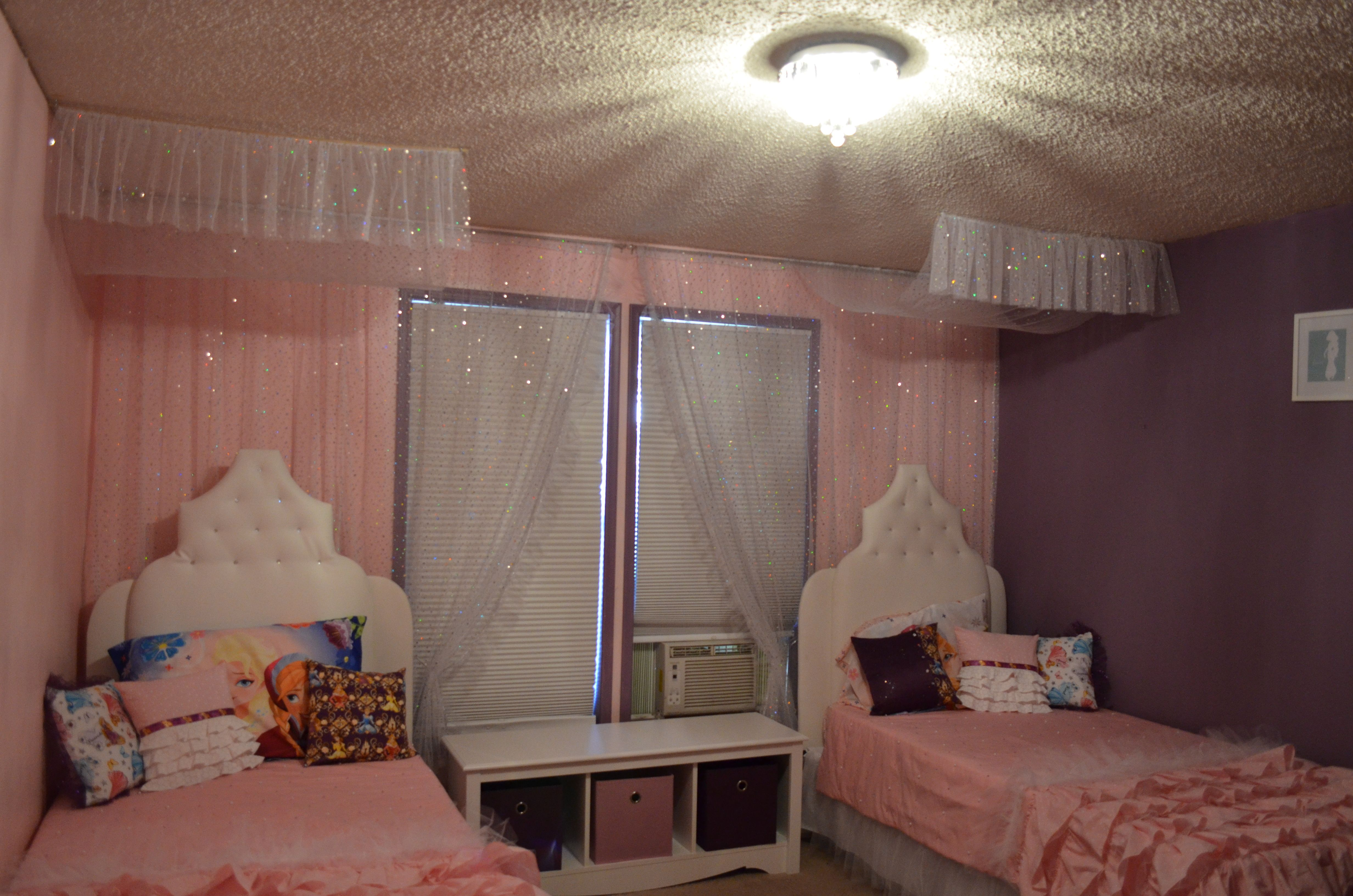 pink polka dot ruffled comforter has tulle between each layer of