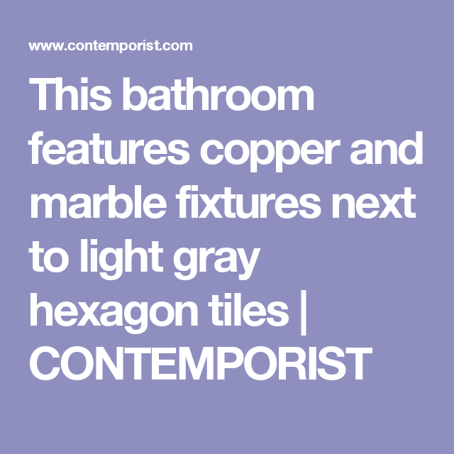 Photo of This bathroom has copper and marble fittings alongside light gray hexagon tiles