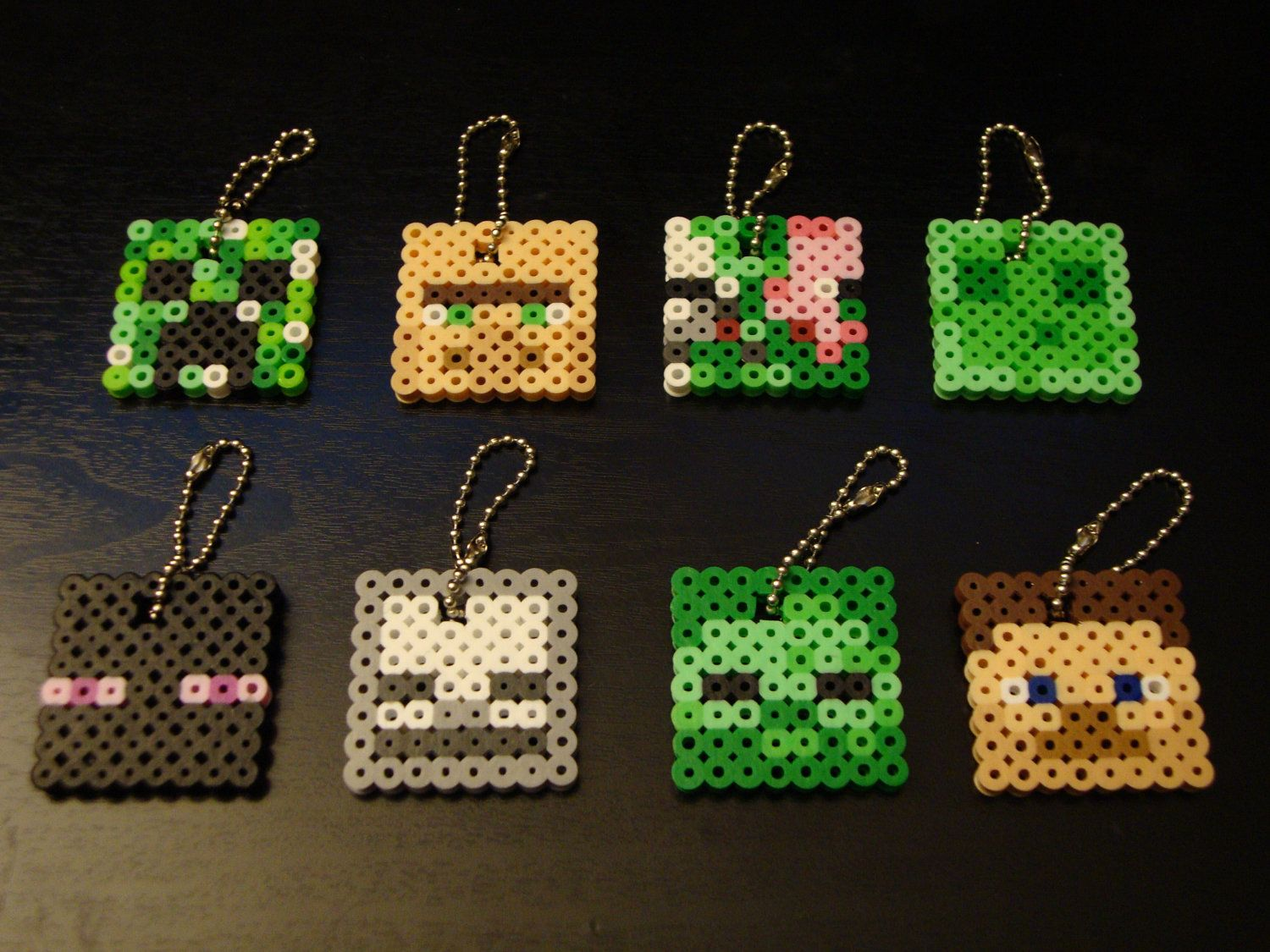 "Minecraft Bead Sprite Keychain - Mincraft Mobs (CHOOSE 1). $2.00, via Etsy.  Instead of buying them made, maybe we can set up a ""station"" where the kids can make their own."