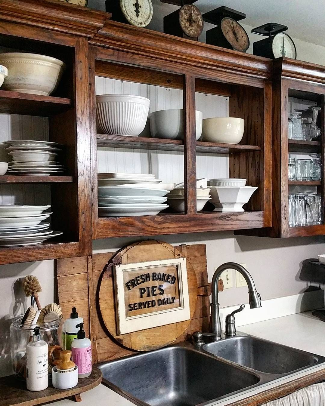 Farmhouse Kitchen Style Cabinets With The Doors Removed Open