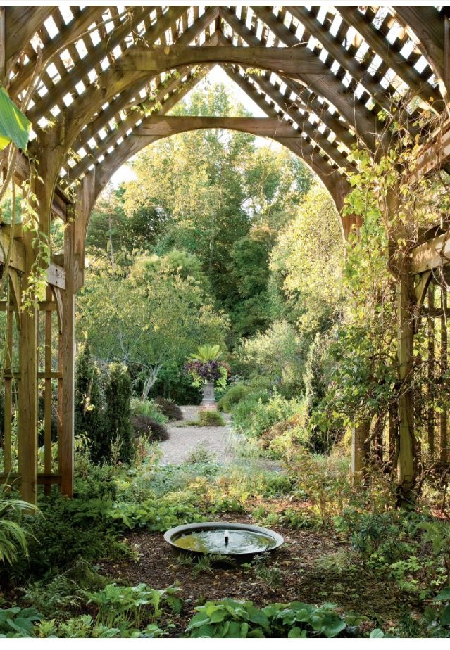 A lath house defines the shade garden and leads to a lushly planted urn in the color garden in this historic North Carolina garden