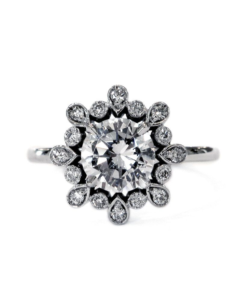 Fleurette is a whimsical diamond engagement ring that is destined to become an heirloom. #uniqueengagementrings #halo #danawaldenbridal