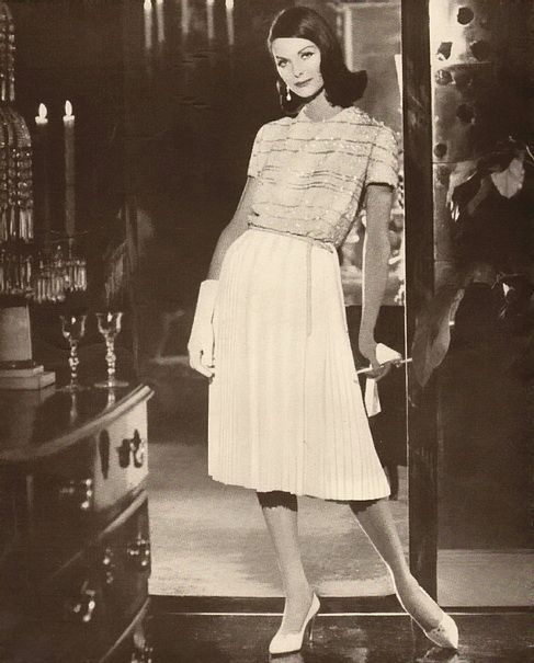 Anne St Marie wearing an ensemble by Larry Aldrich, 1959.