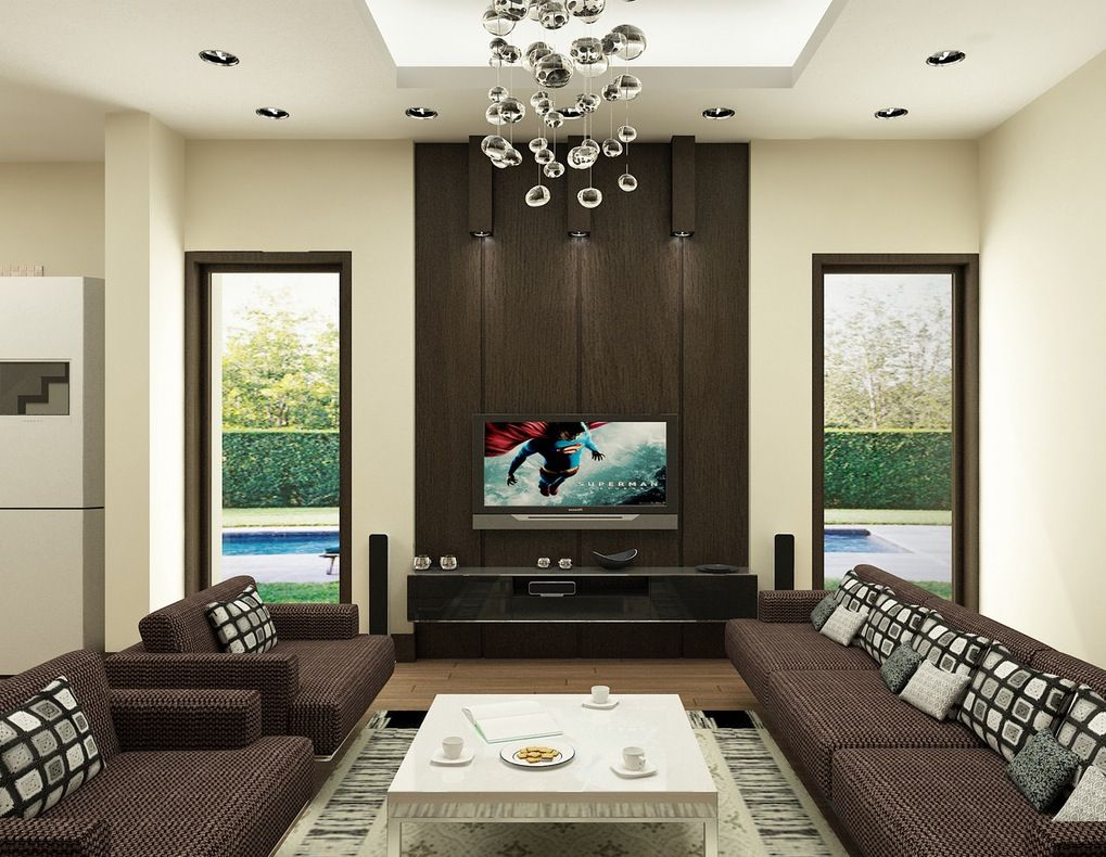 Like dark brown contrasted with white hanging contemporary chandelier couch fabric pattern Brown Living RoomsLiving Room