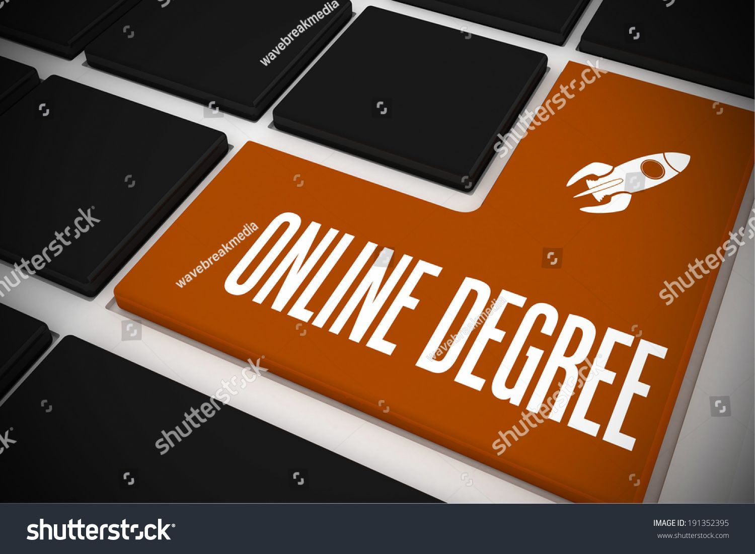 The word online degree and rocket ship on black keyboard with orange key