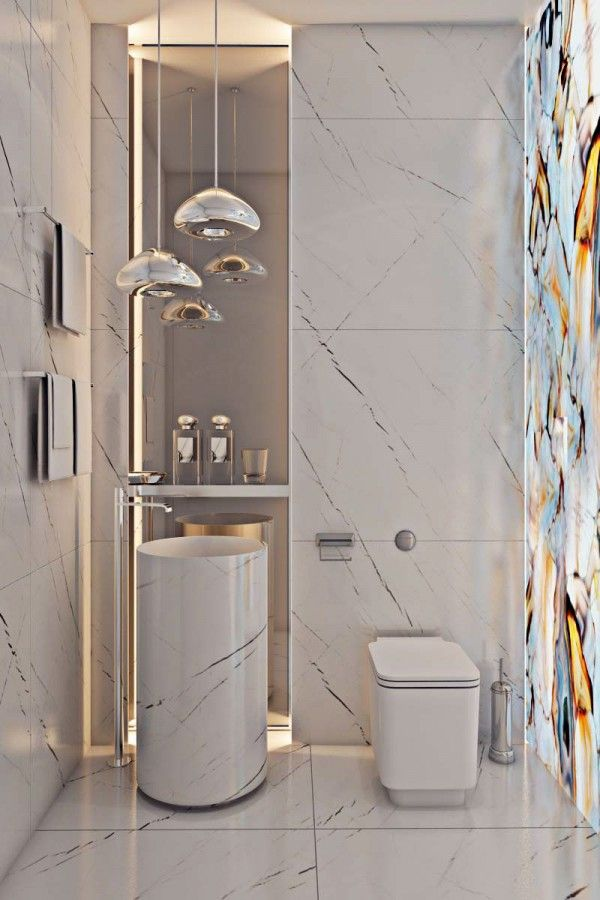 Classic white granite sparkles with chrome fixtures with stunning stained glass on the wall flowing in miami apartmentsbathroom